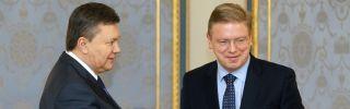 Ukrainian President Viktor Yanukovych (L) welcomes European Commissioner for Enlargement and European Neighborhood Policy Stefan Fuele prior their talks in Kiev on February 8, 2013.