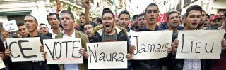 """Algerian demonstrators carry placards reading """"This vote will never take place"""" in French in regard to the Dec. 12 presidential election, during a march in Algiers on Dec. 6, 2019."""