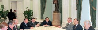 Russian president boris yeltsin sits in a meeting with leading national bankers.