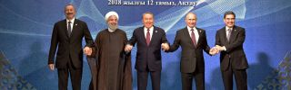 (L-R) Azerbaijan's President Ilham Aliyev, Iranian President Hassan Rouhani, Kazakhstan's President Nursultan Nazarbayev, Russian President Vladimir Putin and Turkmenistan's President Gurbanguly Berdymukhamedov pose after the signing ceremony at the 5th Caspian Summit in Aktau on August 12.