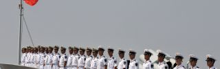 Members of the Chinese Navy stand at attention.