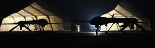 A U.S. Air Force MQ-1B Predator unmanned aerial vehicle returns from a mission to an air base in the Persian Gulf region on Jan. 7, 2016.