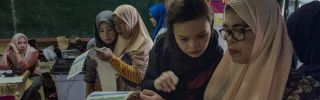 Residents cast their votes in Philippine national and midterm elections on May 13, 2019, in Malabang, Lanao del Sur, in the southern Philippines.