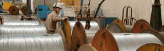 A worker handles steel cables at a factory in Nantong, China, on July 3, 2018.