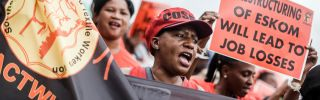 Members of the Congress of South African Trade Unions demonstrate on Feb. 13, 2019, as part of a nationwide strike to protest a possible restructuring on Eskom, South Africa's state-owned electric utility.