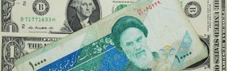 This photo shows 10,000 Iranian rials on top of U.S. dollars.