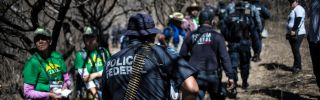 Mexican Federal Police officers participate in the fourth National Search Brigade for people who have gone missing in the drug war in Huitzuco de los Figueroa, Guerrero, on Jan. 21, 2019.