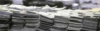 Stacks of ballot papers sit on a table during the count of the Dublin Constituency for the European Parliamentary elections at the Royal Dublin Society in Dublin, Ireland.