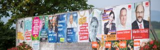 Campaign placards for various parties are seen during German federal elections on Sept. 24, 2017 near Bayrischzell, Germany. Chancellor Angela Merkel's conservative Christian Democratic Union (CDU) won the largest portion of the vote, while another five parties received enough support to gain seats in parliament. With so many voices earning a say, the negotiations could take weeks if not months.