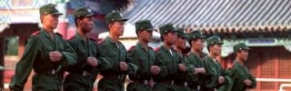 People's Liberation Army troops march near their Tiananmen Square barracks in 1993, four years after the suppression of protesters.