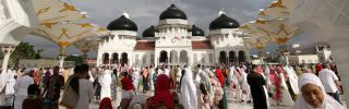 """Indonesian Muslims offer Eid al-Fitr prayers at a mosque in Banda Aceh. Over the next two years, President Joko """"Jokowi"""" Widodo will need political acumen to counter the opposition's appeal to Islamist sentiment to keep his ruling coalition together."""