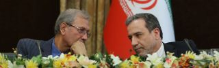 A handout picture provided by the Iranian presidency on July 7, 2019, shows Iran's government spokesman Ali Rabiei, left, and Deputy Foreign Minister Abbas Araghchi during a news conference in Tehran.