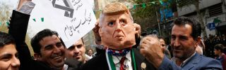 Protesters pretend to hit a man wearing a mask of U.S. President Donald Trump during an April 12, 2019, rally in the Iranian capital of Tehran.