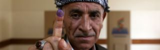 An man shows his ink-stained finger after voting in Iraqi Kurdistan's independence referendum in Arbil on Sept. 25.