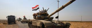 Iraqi forces drive toward peshmerga positions on Oct. 15 near Kirkuk.