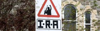 An IRA sniper warning sign on April 20, 2019, overlooking the Bogside area of Londonderry in Northern Ireland.