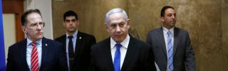 Israeli Prime Minister Benjamin Netanyahu (C) arrives at a weekly Cabinet meeting in Jerusalem on Dec. 8, 2019.