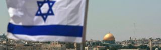 An Israeli flag flies over the city of Jerusalem.