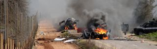 Israeli military vehicles burn after a Hezbollah missile attack in the disputed Shebaa Farms area of southern Lebanon on Jan. 28, 2015. The attack killed two Israeli soldiers and prompted an Israeli military response.
