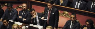 Italian Prime Minister Giuseppe Conte announces his resignation in the country's Senate on Aug. 20, 2019, as Deputy Prime Minister Matteo Salvini gestures beside him.