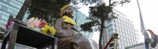 """A statue of a girl that commemorates the World War II-era issue of """"comfort women"""" stands outside the Japanese Embassy in Seoul."""