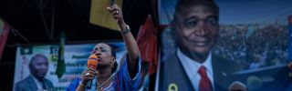 Olive Kabila, the wife of President Joseph Kabila, speaks during an election rally.