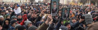People gather to pay tribute to the victims of the March 25 fire at a shopping center in Kemerovo.