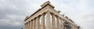 Tourists visit the Parthenon on the Athenian Acropolis in Greece in February.