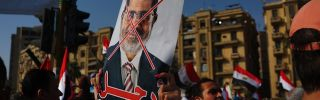 A protester waves an anti-Morsi poster in Tahrir Square on July 3