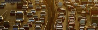 Rush-hour traffic congests the streets of Tianjin on Oct. 10.