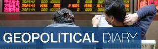 Investors observe stock market data at an exchange hall in Beijing.