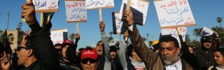 Libyan protesters hold placards as they demonstrate against the extended mandate of the General National Congress, the country's highest political authority, in Tripoli's Martyr Square on Feb. 7.
