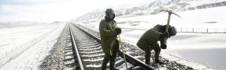 Workers carry out track maintenance along a segment of the Qinghai-Tibet railway