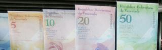 Large reproductions of the Venezuelan bolivar on display in Caracas