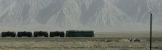 A train passes the Tien Shan mountains in China's far western Xinjiang region