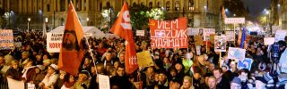 Protesters hold flags and placards during a rally in front of the parliament building in Budapest on Nov.17.