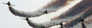 A Saudi air force demonstration squad flies in formation at a 2010 air show in Manama, Bahrain.
