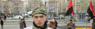 A Ukrainian soldier in Maidan Square asks for donations to support the war effort in eastern Ukraine.