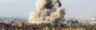 Smoke ascends after a Syrian military helicopter allegedly dropped a barrel bomb over the city of Daraya on Jan. 31.