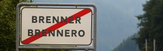 A sign indicates the Brennero city limits at the Brenner Pass on Sept. 3, 2015, in Brennero, Italy. Italian police have announced they will soon reinstate border controls at the Brenner following a request from Germany in order to regulate the flow of migrants. Hundreds of migrants travel via trains and other means through the Brenner Pass daily, the vast majority on their way to Germany.