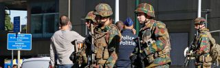 Police and army personnel on guard during a bomb alert outside the Brussels-North train station, Oct. 5.