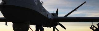 U.S. maintenance personnel check a Predator drone before a surveillance flight near the Mexican border.