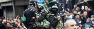 Members of the Izz al-Deen al-Qassam Brigades, Hamas' military wing, take part in a Dec. 14 rally in Gaza City marking Hamas' 29th anniversary. A blockade by Islamic State in the Sinai Peninsula has cut weapons supplies to the Palestinian group.