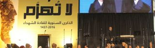 The Head of Lebanon's Shiite movement Hezbollah, Hassan Nasrallah, is seen on a giant screen as he addresses the crowd in a televised speech from an undisclosed location during a rally held in the southern suburbs of Beirut on February 16, 2016, to mark the anniversary of the Israeli killings of Lebanese Hezbollah commanders Ragheb Harb, Abbas al-Mussawi and Imad Mughnieh. Mussawi was killed on February 16, 1992 in an Israeli air raid on Nabatiyeh, Harb was assassinated in south Lebanon during Israel's occu