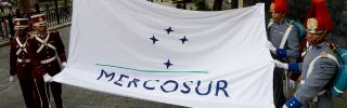 Personnel raise the Mercosur flag in Caracas on Aug. 5. Expelling Venezuela from the trade bloc may not be as easy as its opponents suggest.
