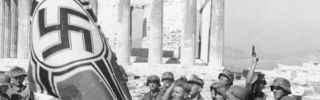 Wehrmacht soldiers raise the Nazi Imperial War Flag over the Acropolis in Athens in May 1941. (SHEERER/Wikimedia)