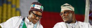 Nigerian President Muhammadu Buhari (L) talks with rival politician Atiku Abubakar in Lagos.