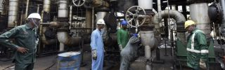 Workers rehabilitate the new Port Harcourt oil refinery in Port Harcourt, Nigeria, on Sept. 16.