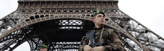 French soldiers patrol in front of the Eiffel Tower on Jan. 7, 2015 in Paris.