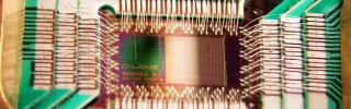 A D-Wave Systems chip designed to operate as a 128-qubit superconducting adiabatic quantum optimization processor.